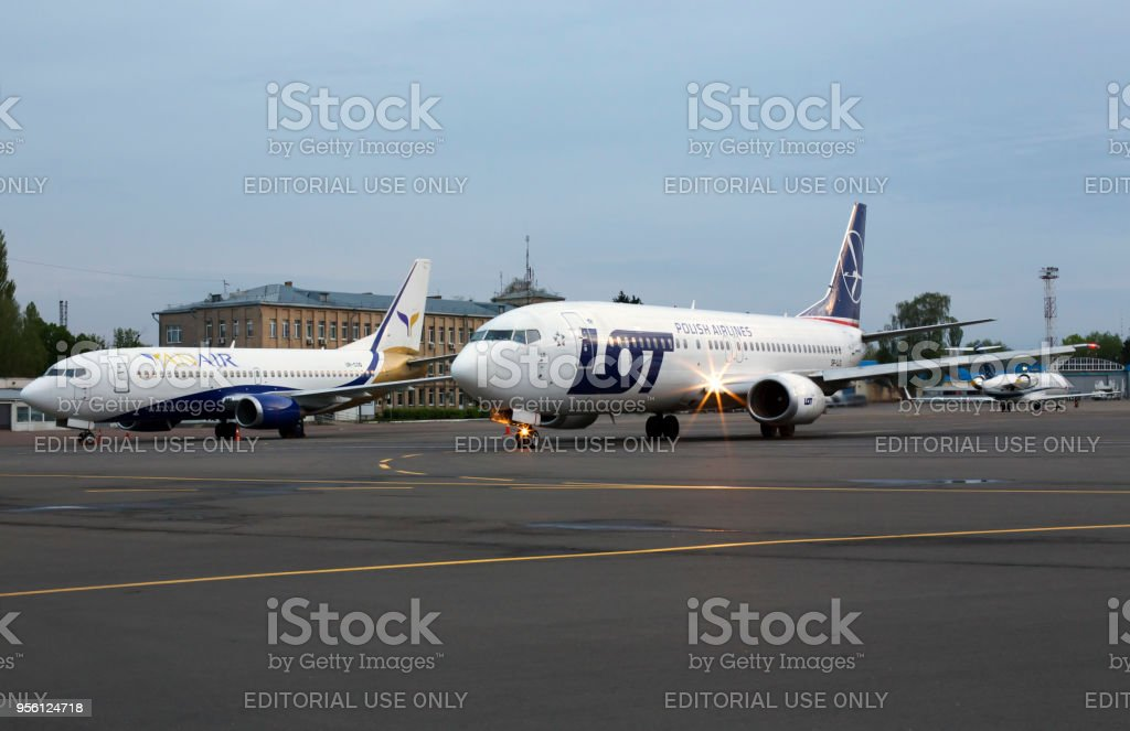 UR-COG YanAir Boeing 737-300 and SP-LLG LOT - Polish Airlines Boeing 737-400 aircrafts on the parking zone stock photo