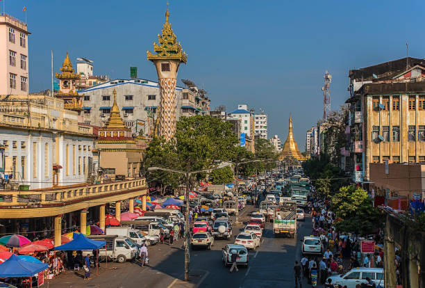 Yangon city in Myanmar Main street leading to the Sule pagoda in Yangon city, a normal day in Myanmar capital myanmar stock pictures, royalty-free photos & images