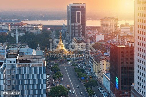 01/22/2020 Yangon, Myanmar (Burma), Aerial shot, view from the drone on the downtovn of Yangon with Shwedagon Pagoda and street traffic at sunset pop colors. Yangon - the ancient capital of Burma