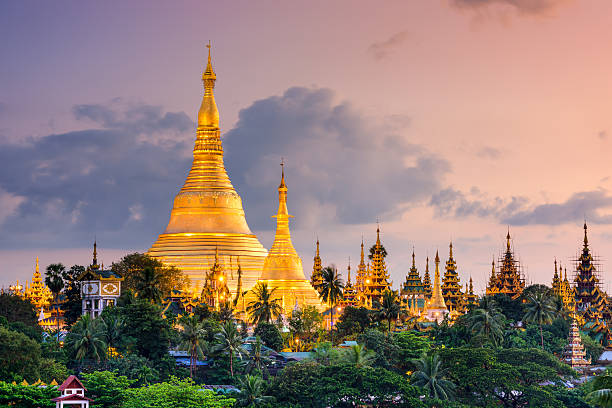 Yangon Myanmar at Shwedagon Pagoda Yangon, Myanmar view of Shwedagon Pagoda at dusk. pagoda stock pictures, royalty-free photos & images