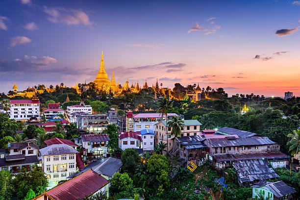 Yangon Myanmar Yangon, Myanmar skyline with Shwedagon Pagoda. myanmar stock pictures, royalty-free photos & images