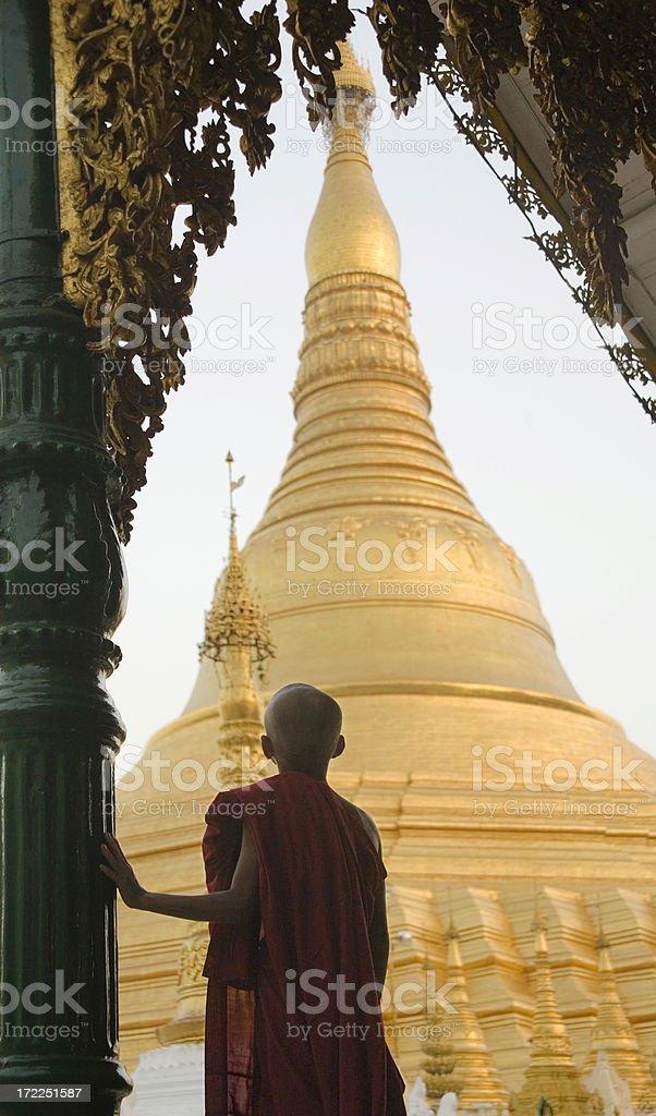 Yangon, Myanmar: Shwedagon Pagoda and Monk in Evening Light royalty-free stock photo