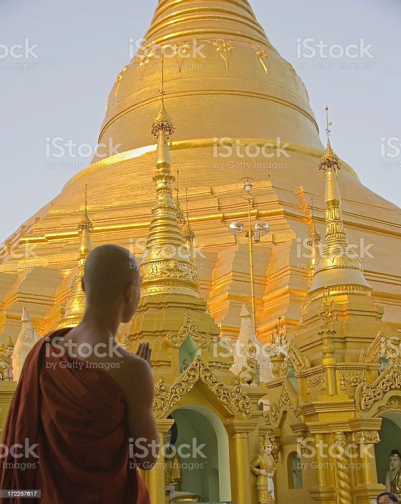 Yangon, Myanmar: Shwedagon Pagoda and Monk in Evening Light royalty-free stock photo