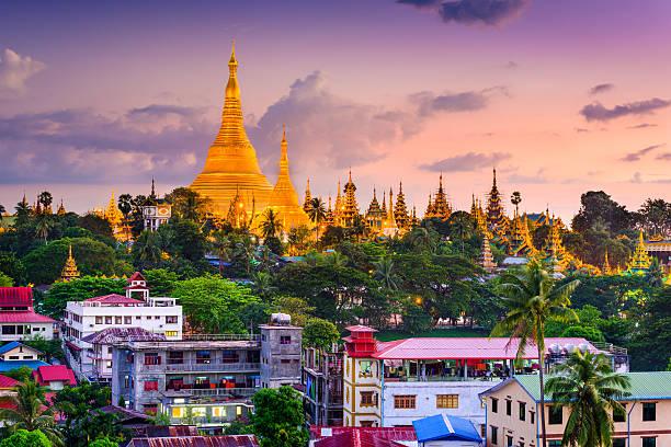 Yangon Skyline Yangon, Myanmar skyline at Shwedagon Pagoda. myanmar stock pictures, royalty-free photos & images