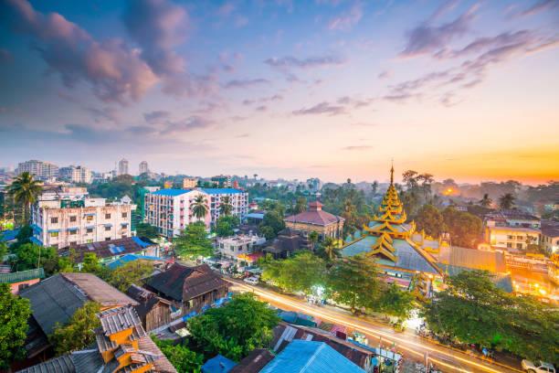 Yangon skyline with Shwedagon Pagoda  in Myanmar Yangon skyline at twilight with Shwedagon Pagoda  in Myanmar myanmar stock pictures, royalty-free photos & images