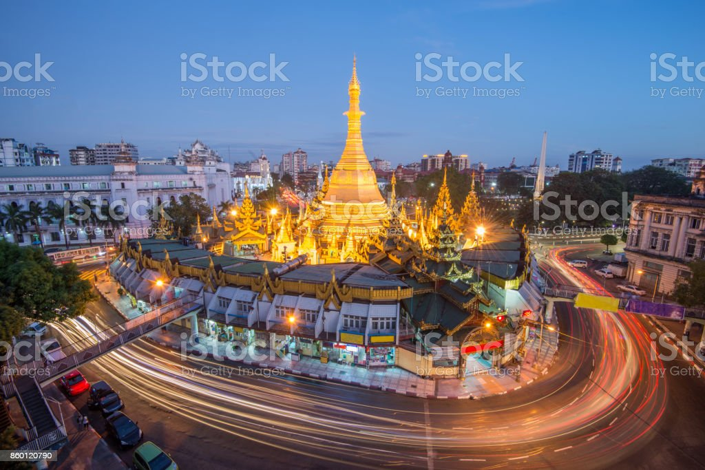 yangon the old capital city of myanmar.yangon traffic with long exposure at sule pagoda famous landmark after sunset yangon,myanmar stock photo