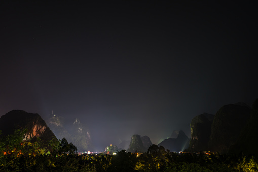 Night view of the karst mountain landscape surrounding Yangshuo town, Guangxi Province, China