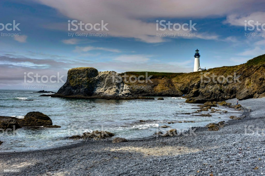Yaquina Head Lighthouse at Pacific coast Coastel View with beach stock photo
