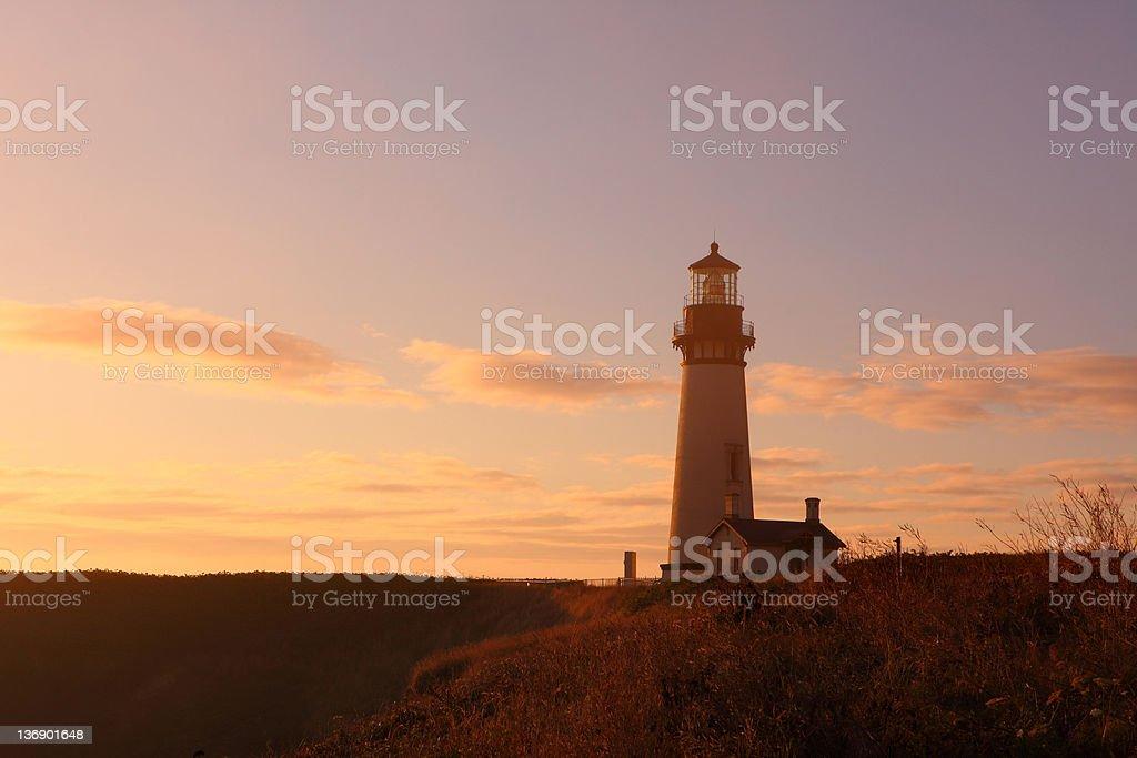 Yaquina Head Lighthouse at sunset, Newport, Oregon stock photo