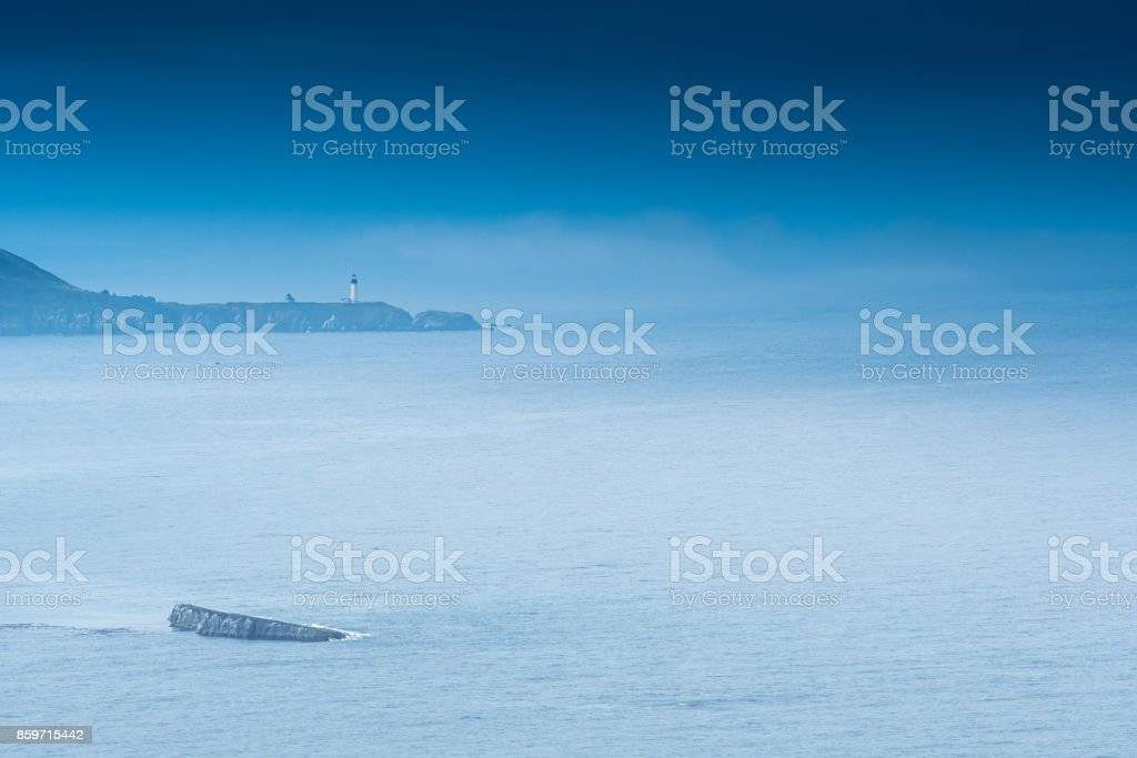 Yaquina Head Lighthouse Viewed from the Northern Coast stock photo