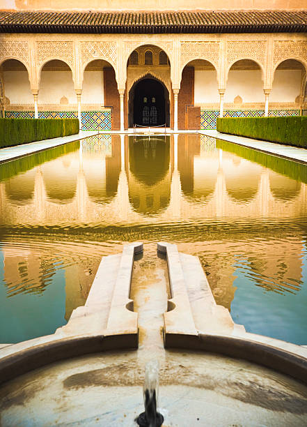 Yard in Nasrid Palace Pond in Nasrid Palace - part of Alhambra complex in Granada, Spain. palacios nazaries stock pictures, royalty-free photos & images
