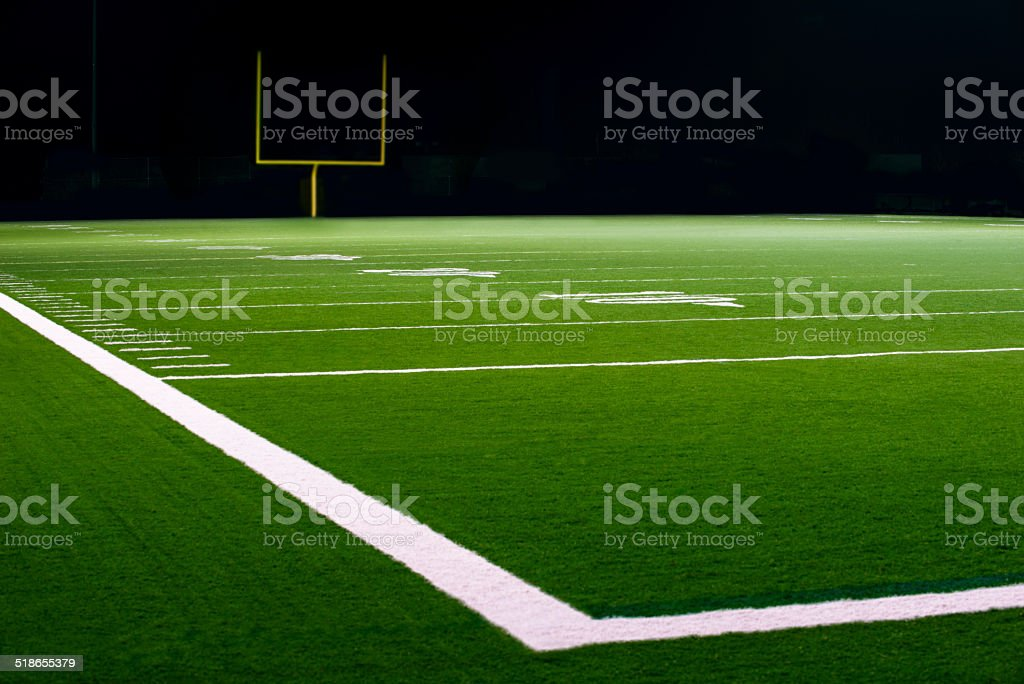 Yard Numbers and Line on American Football Field at Night stock photo
