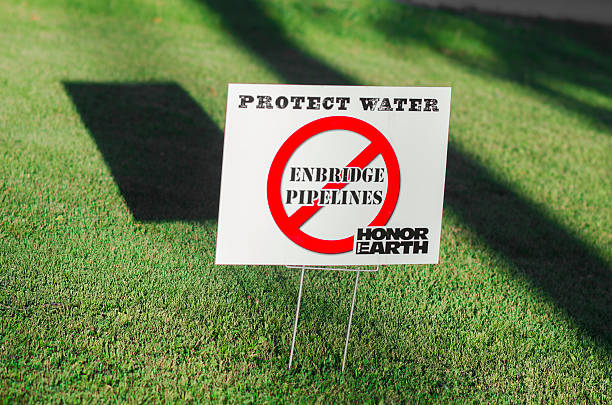 Yard sign promoting conservation of water over oil stock photo