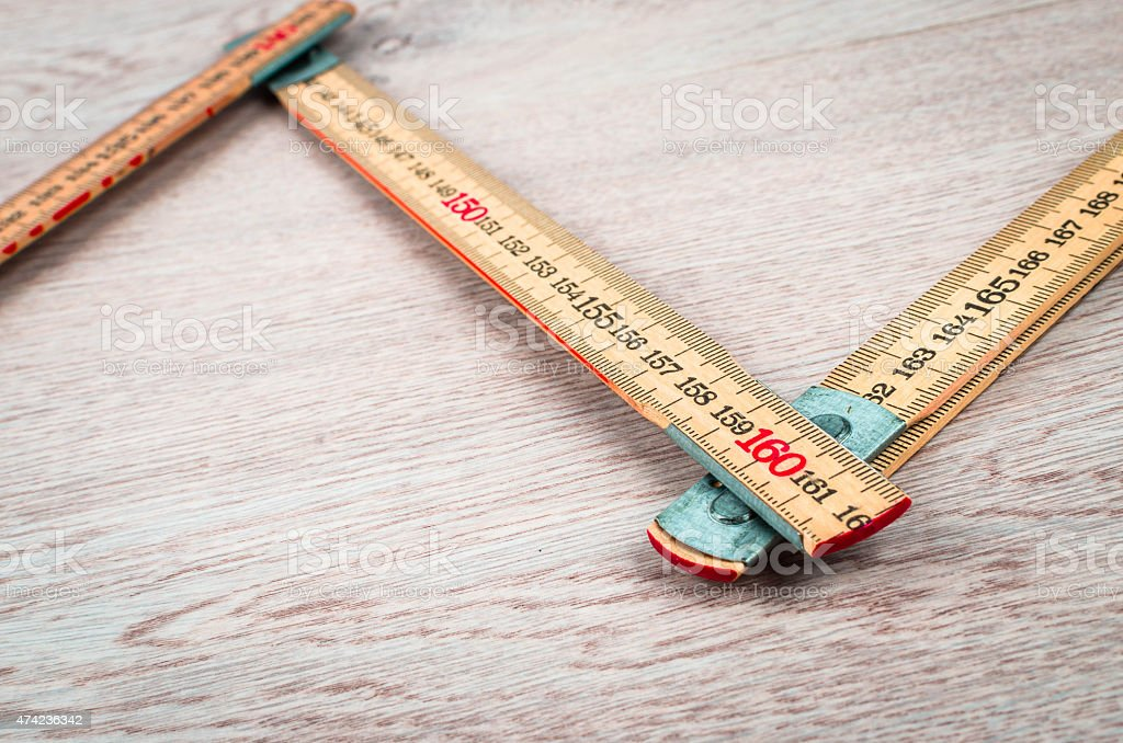 Yard stick on white oak background stock photo