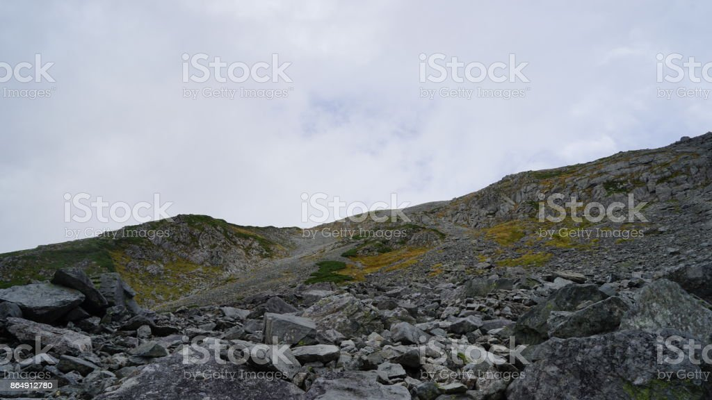 Yarigatake mountaineering. The state which judged the mountain top direction in Minamidake from Minamisawa from a guidepost spot to Minamidake shed stock photo