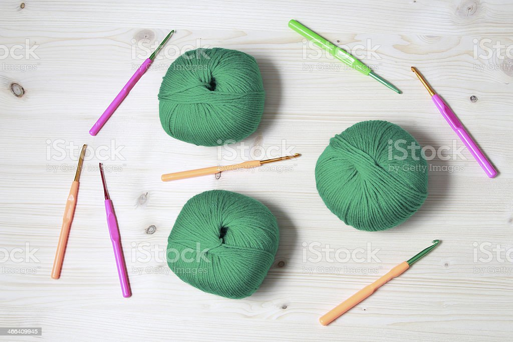 Yarn and crochet hooks stock photo