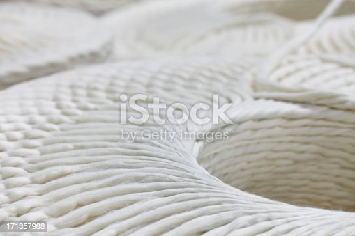 Close up view of cotton threads in a barrel