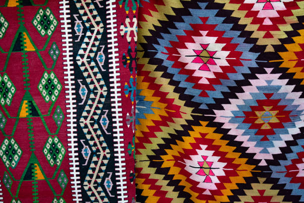 Yarn texture of traditional Turkish ethnic patterned carpet closeup stock photo