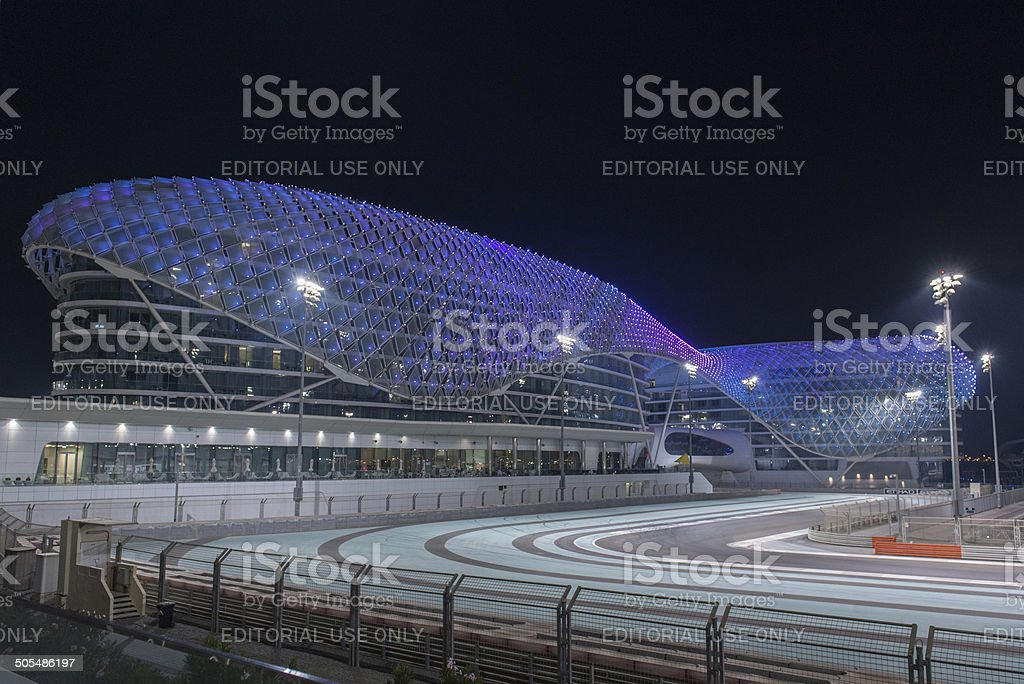 Yas Viceroy hotel at night, with illuminated race track stock photo