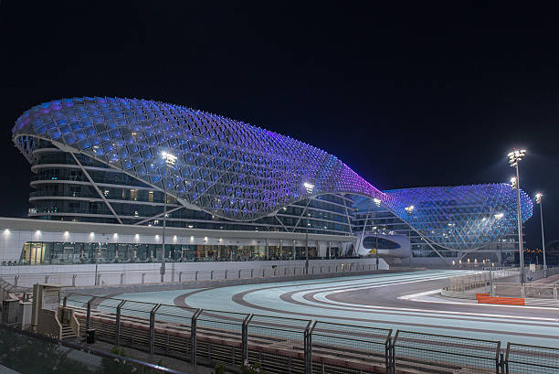 yas viceroy hotel at night, with illuminated race track - formula 1 stok fotoğraflar ve resimler