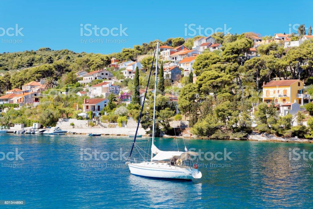 Yatch in the harbor of a small town Splitska - Croatia, island Brac stock photo