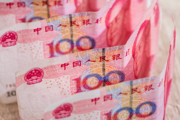 100 yaun bills on desk. Financial investment. 100 yaun bills on desk. Financial investment. chinese currency stock pictures, royalty-free photos & images
