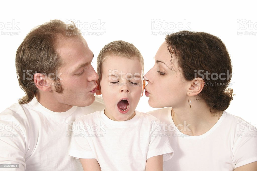 yawn boy with kissing parents royalty-free stock photo