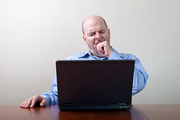 Yawning businessman stock photo
