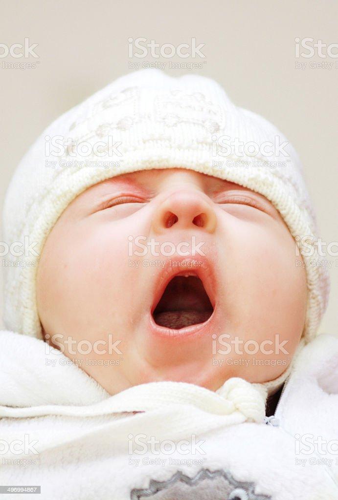 Yawning toddler stock photo
