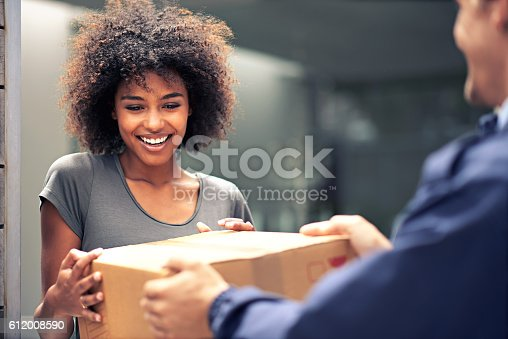 Shot of a courier making a delivery to a smiling customer