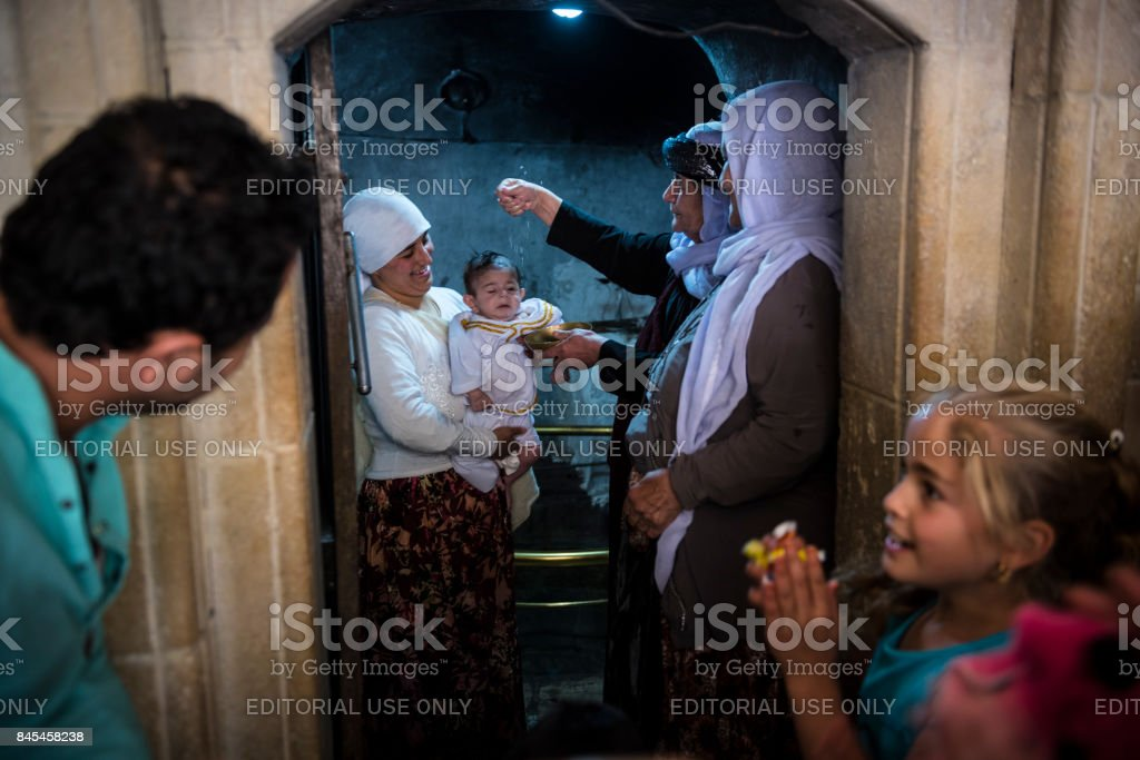Yazidi infant baptism in Lalish, Iraq stock photo