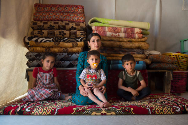 Yazidi mother and children in IDP camp stock photo