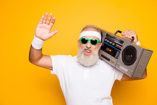 Yeah bro! What`s up? Cheerful excited aged funny sexy gangster cool grandpa dude in eyewear with bass clipping ghetto blaster recorder. Old school, swag, fooling, gym, technology, success, hip hop