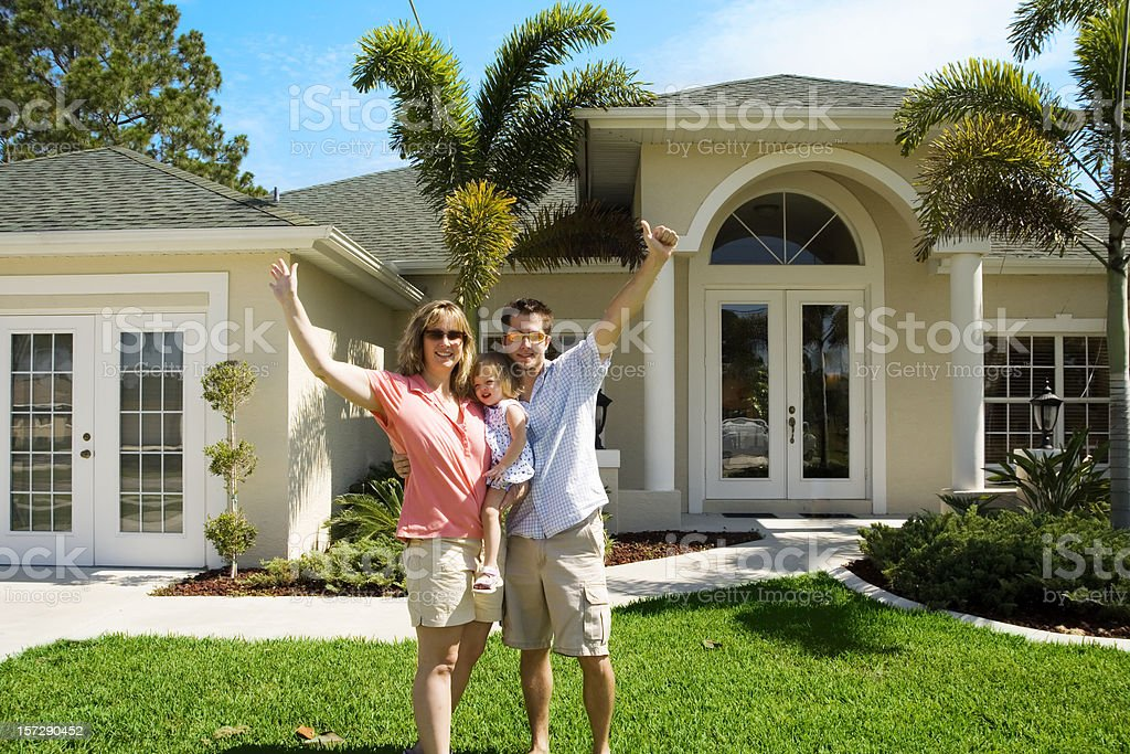 Yeah! We bought our first home! stock photo