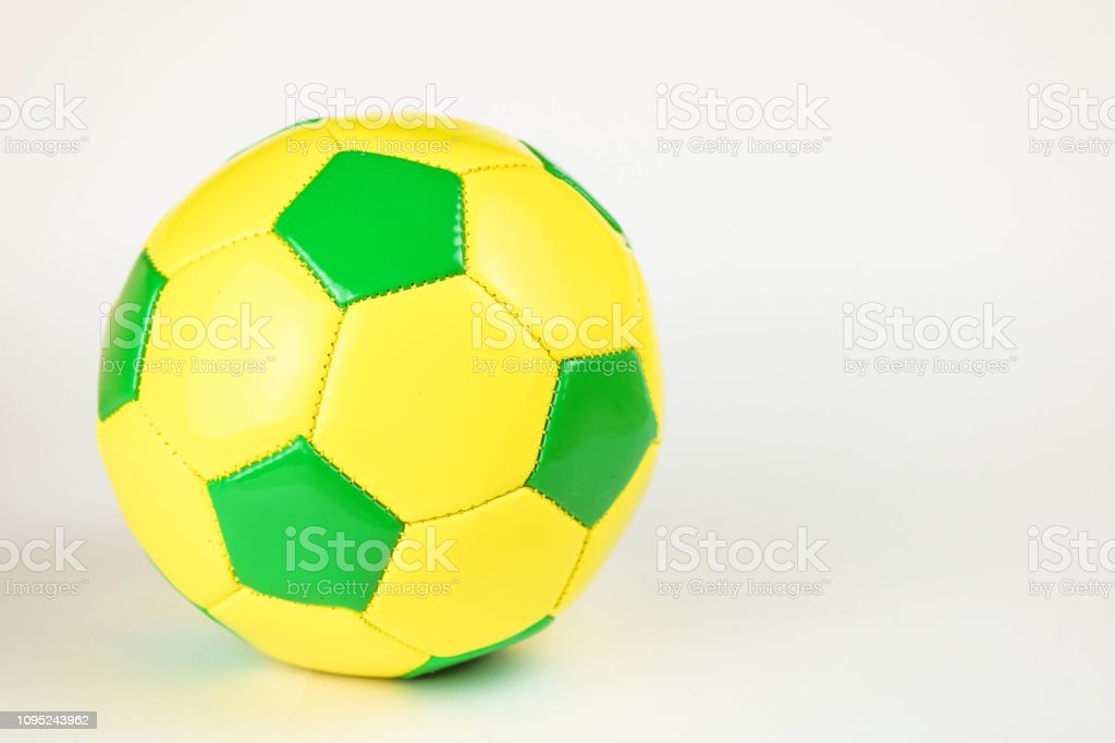 Yeallow and green football ball on white background.