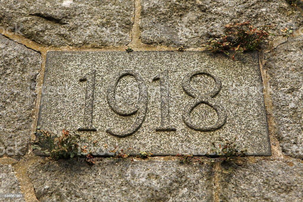 Year 1918 of World War I carved in stone. stock photo