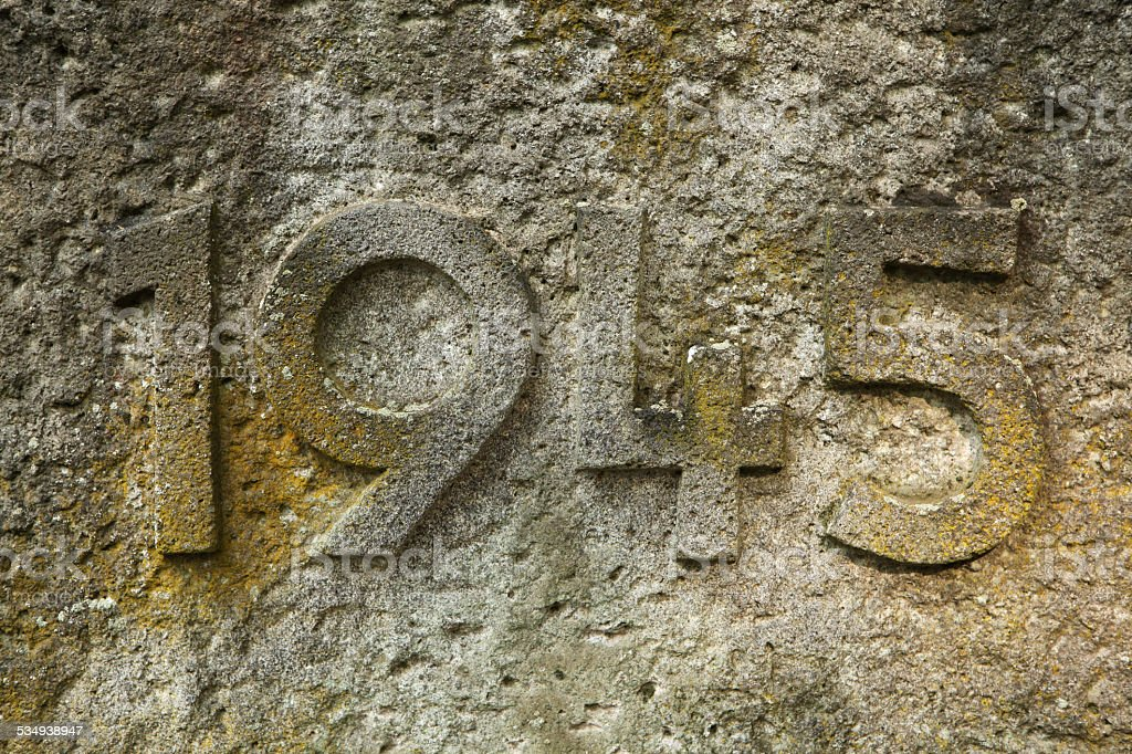 Year 1945 of World War II carved in stone. stock photo