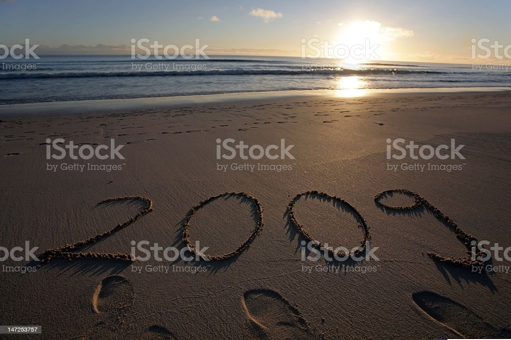 Year 2009 scripted into sand royalty-free stock photo