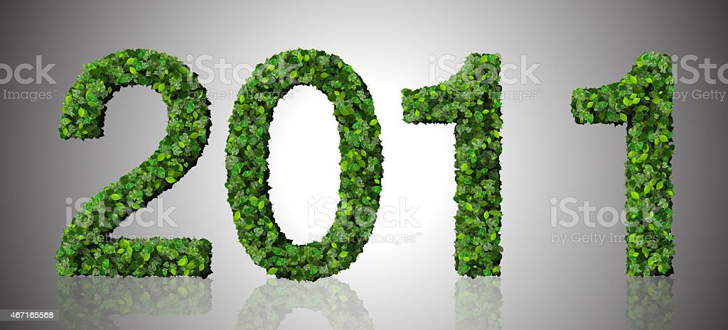 Year 2011, date made from green leaves on gradient background. stock photo