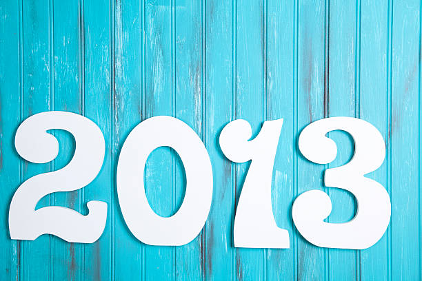 Year 2013 date in white numbers on rustic blue background Year 2013 date in white numbers on rustic blue background 2013 stock pictures, royalty-free photos & images