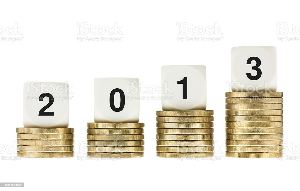 Year 2013 on Stacks of Gold Coins with White Background royalty-free stock photo