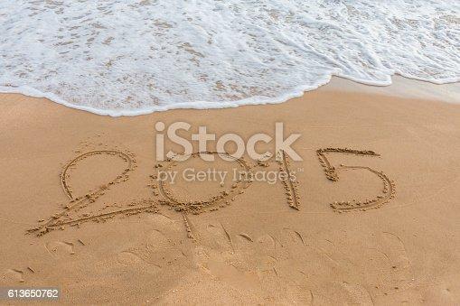 istock Year 2015 on the beach 613650762