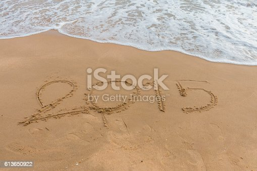 istock Year 2015 on the beach 613650922