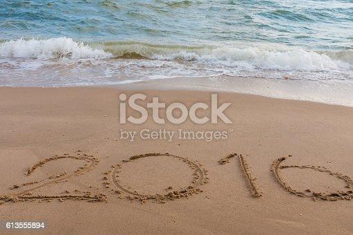 istock Year 2016 on the beach 613555894