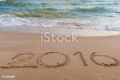 istock Year 2016 on the beach 613555962