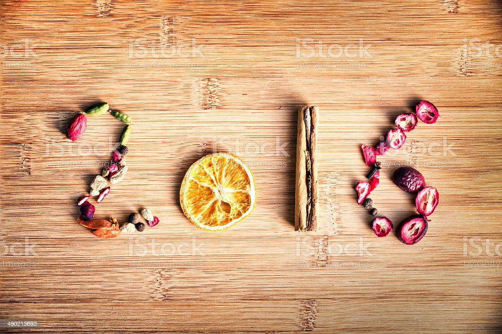 Year 2016 written with spices on wooden background stock photo