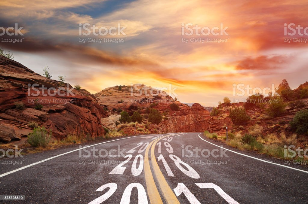 Year 2017 changing to 2018 - country road stock photo