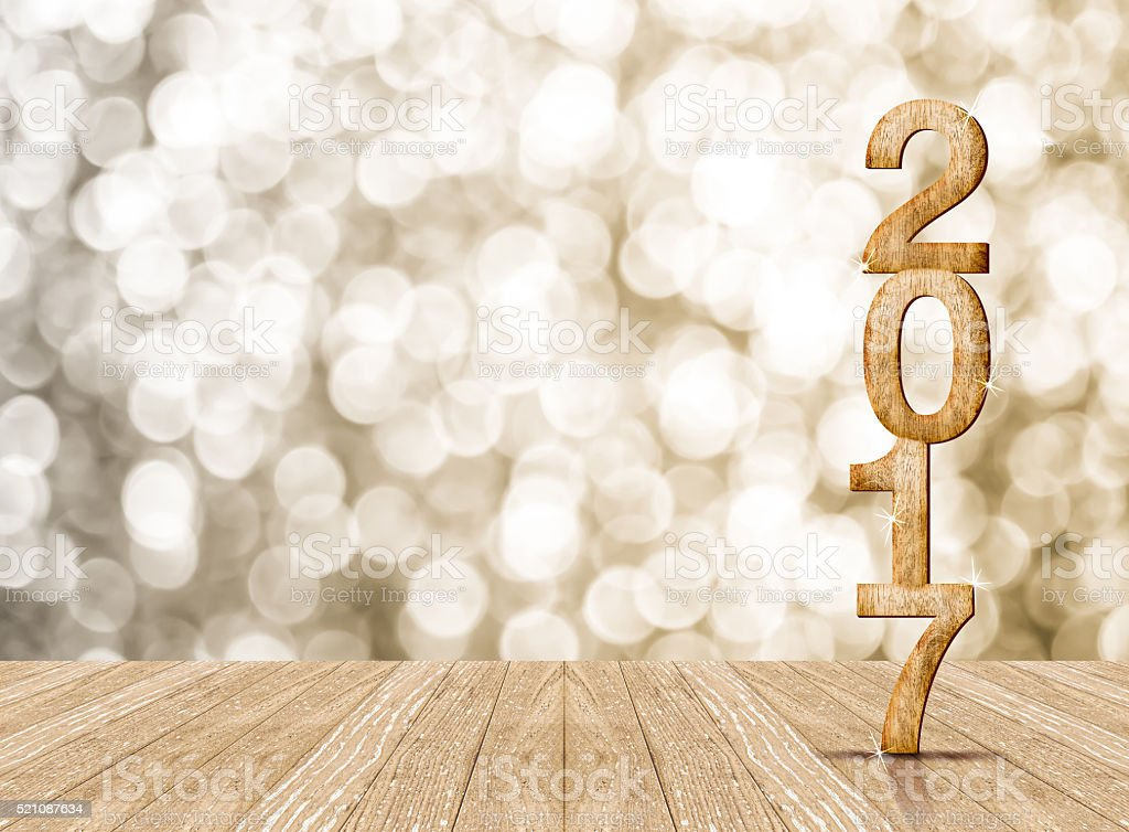 Year 2017 wood number in perspective room with sparkling bokeh stock photo