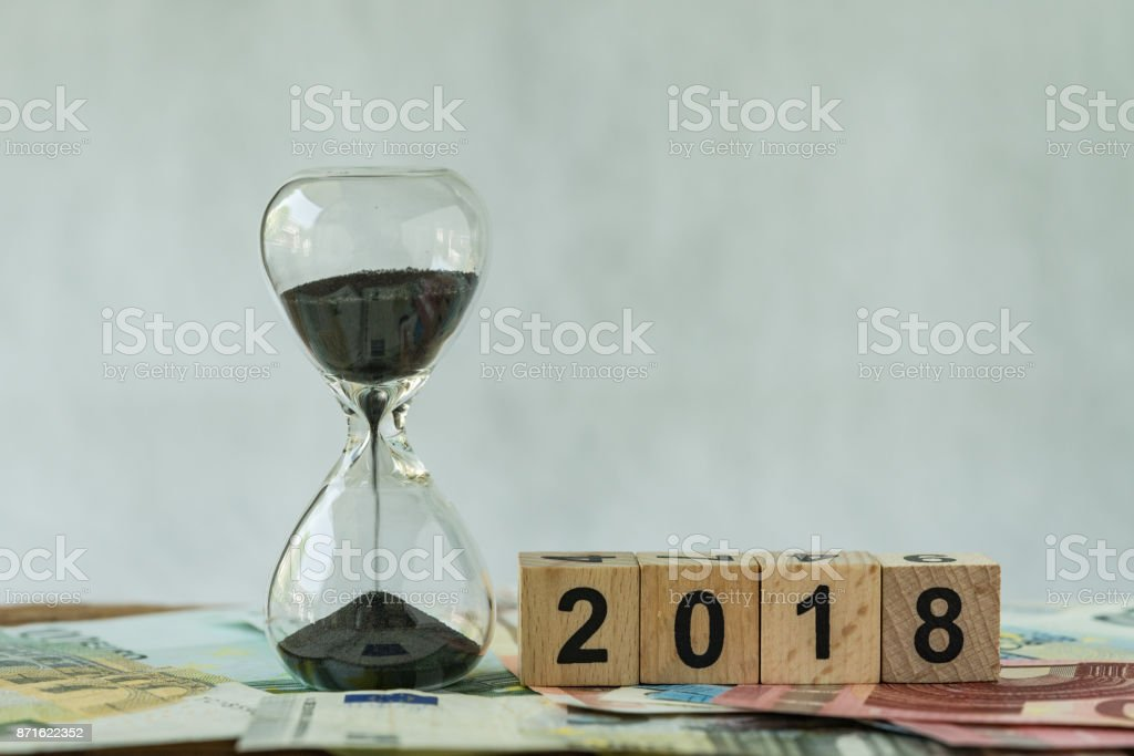 Year 2018 business time countdown or long term investment concept as...