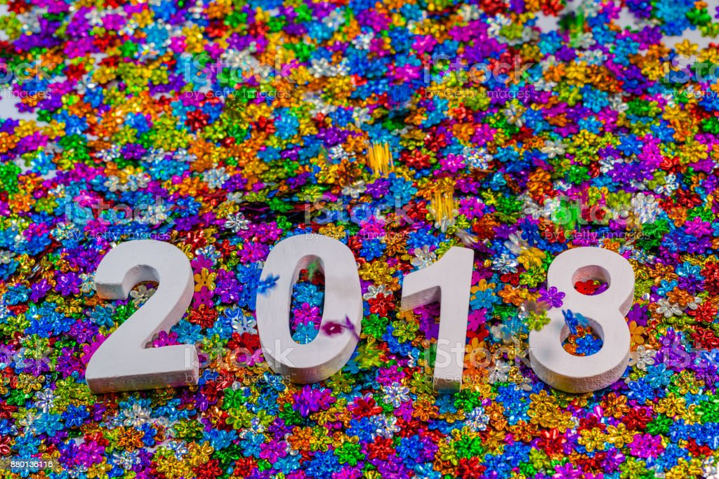 year 2018 on colorful flowers glitter. stock photo